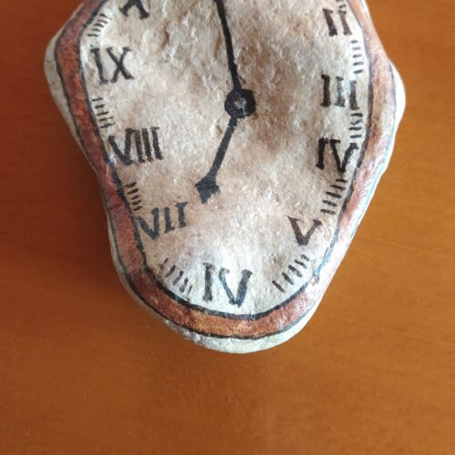 Angeles reloj de Dalí